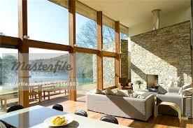 large windows in modern living room stock photo