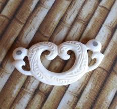 hand carved bone pekapeka manaia pendant with paua eyes from new zealand