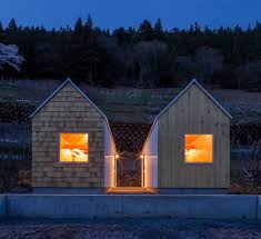 Small Picture Twin micro homes by S Plus One are finished in different woods