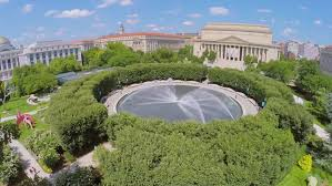 fountain in national gallery of art sculpture garden near edifices of national archive department of justice and museum of natural history at summer sunny