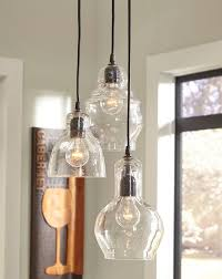 3 glass pendant lights with exposed bulbs