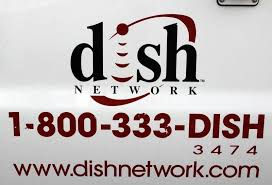 the dish network logo on the side of installers truck is seen in denver dish network installers