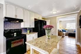 white kitchens with black appliances. White Kitchen Cabinets With Black Appliances. Island Granite Top Decorated Flowers Stock Kitchens Appliances N