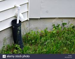 A Residential Home With A Drain Pipe On The Exterior Stock Photo - Exterior drain pipe