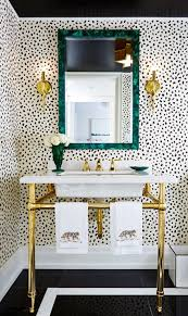 Powder Room Wallpaper A Patterned Powder Room Gold Faucet Green Mirrors And White