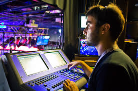 lighting technician at work in booth