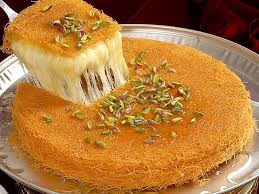 knafeh is a delightful sweet melted cheese dessert that is por in the middle east