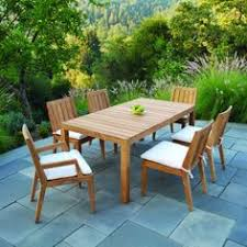 kingsley bate elegant outdoor furniture st tropez stacking armchairs in sand with wainscott dining table teak teak armchairs and porch