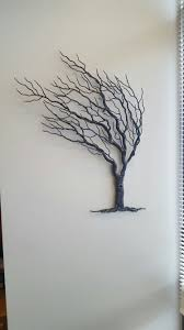 metal wall art tree blowing wind