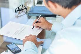 businessman making notes at desk b93df78c9b46e