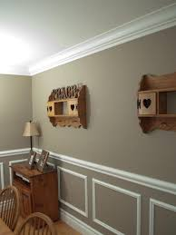 chair rail moulding maybe add stencils inside bo love the wainscoting