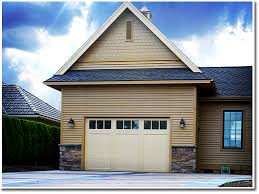 the large bifold door blends seamlessly into the exterior of the garage making it look as though it s only 8 ft tall