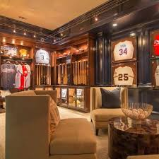 Baseball man cave with bats and jerseys