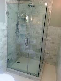 matching bathroom shower glass door with marble tile bathroom wall