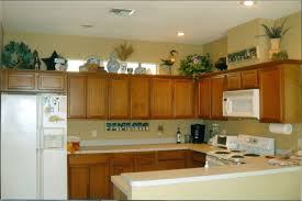decorations on top of kitchen cabinets. Kitchen : Decorating Top Of Armoire Ideas For Space Above Refrigerator Cabinet Lighting Storage Cabinets Decorations On R