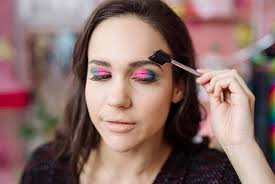 once your lash glue and or mascara has dried take your tiny eyeshadow brush and apply your third shade of eyeshadow to your bottom lash bed from the inner