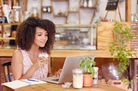 beautiful young freelancer working on her laptop in a coffee with wifi