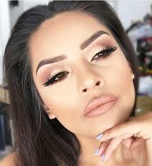 light golden base with double winged eyeliner on brown eyes