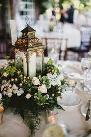 decorations for wedding tables. Opt For Timeless Lantern Centerpieces, Dressed Up With Greens, Berries, Flowers And Candles Your Wedding Day. Decorations Tables