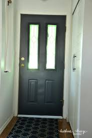 dark gray door with white vinyl door sweep on the bottom