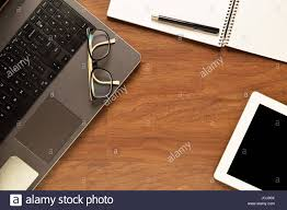items home office. Top View Of Tablet, Laptop And Office Items On A Wooden Desk. Home Concept C