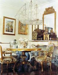 a touch of design leopard chairs and a jennifer nicholson crystal ship chandelier