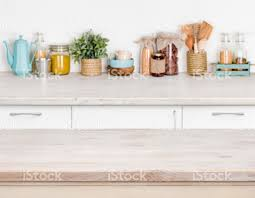 kitchen table with food. Wooden Kitchen Table Over Blurred Furniture Shelf With Food Ingredients Royalty-free Stock Photo M