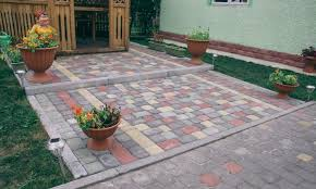 stamped concrete vs pavers which is