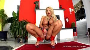 Clara G masturbates with an enormous dildo anally PornDoe