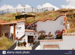 Old Cave houses in Guadix, Andalucia, Spain. Up to 10,000 people still lie  in cool underground houses dug out of the rock