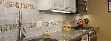 white glass subway backsplash tile