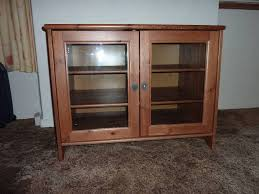 ikea leksvik solid pine tv cabinet with glass doors in port intended for solid pine