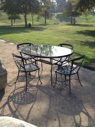 image of enthralling refinishing iron patio furniture of antique black metal dining chairs also round glass