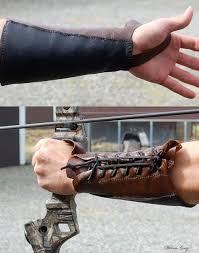 a bracer or arm guard is a strap or sheath commonly made of leather stone or plastic that covers the inside of an archer s arm to protect it