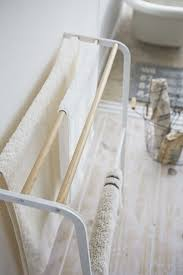 Bath towel hanger Towel Rack Wall Mount Tosca Leaning Bath Towel Hanger In White Design By Yamazaki Burke Decor Tosca Leaning Bath Towel Hanger In White Design By Yamazaki Burke