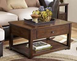 ashley furniture marion dark brown lift top cocktail table to enlarge