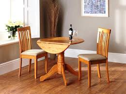 ikea drop leaf table and 2 chairs dining room dark wood with fold away small round