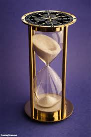 Hour glass and clock.