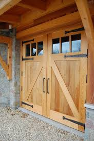 looking more closely at the garage doors the strap hinges and heavy steel handles contrast against western red cedar wood d24