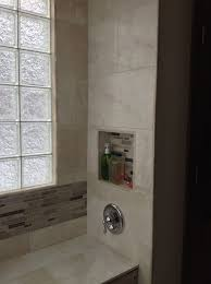 glass block shower window with tile on the inside