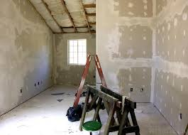 joint tape is applied over the joints between sheets of drywall then mudded and sanded to create an invisible seam