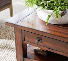 We love the intentional weathering throughout, which lets the wood's natural grain color variation shine through. Benchwright 36 Square Coffee Table Pottery Barn