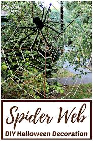 diy spider web decoration made with bare branches