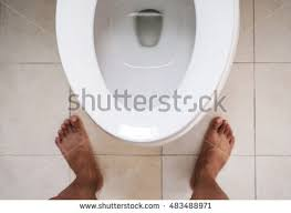 toilet seat top view. Top View, Toilet Lavatory With Bare Feet Standing, Focus On Seat View
