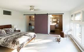 Master bedroom doors French Midcentury Bedroom With Barn Door For Bathroom And Office Space design Design Platform Pinterest 25 Bedrooms That Showcase The Beauty Of Sliding Barn Doors