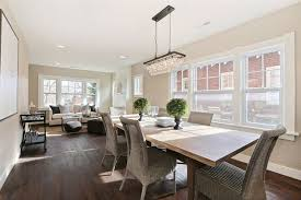 dining room with high ceiling chandelier in denver co