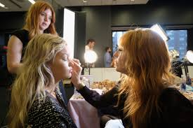 model maggie laine getting her makeup done by charlotte tilbury at the makeup test two days