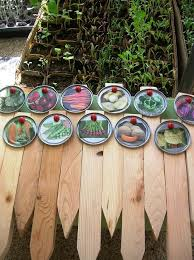 diy juice lid garden markers made with seed packets