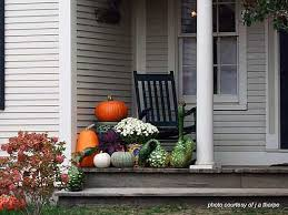 autumn decorating porch with foliage