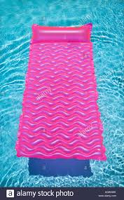 pool water with float. Pink Lounge Float In Empty Swimming Pool With Rippling Blue Water O